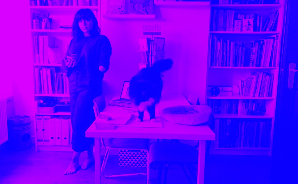 Portrait of Julie Vangeel in her studio with her cat